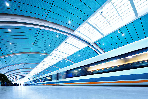 "Futuristic Train ""Futuristic Train in Shanghai, ChinaShanghai Maglev Train or Shanghai TransrapidMagnetic levitation train - the fastest passenger train currently in service (431km/h) Long Exposure , Blurred Motion"" aerodynamic stock pictures, royalty-free photos & images"