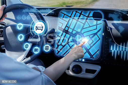 829192098 istock photo futuristic vehicle and graphical user interface(GUI). intelligent car. connected car. Internet of Things. Heads up display(HUD). 829192200