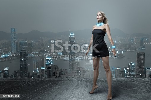 istock Futuristic woman in night city 482598234