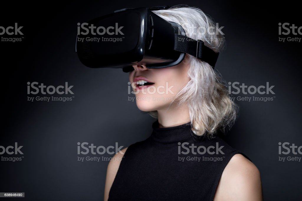 Futuristic Woman with Virtual Reality Headset stock photo