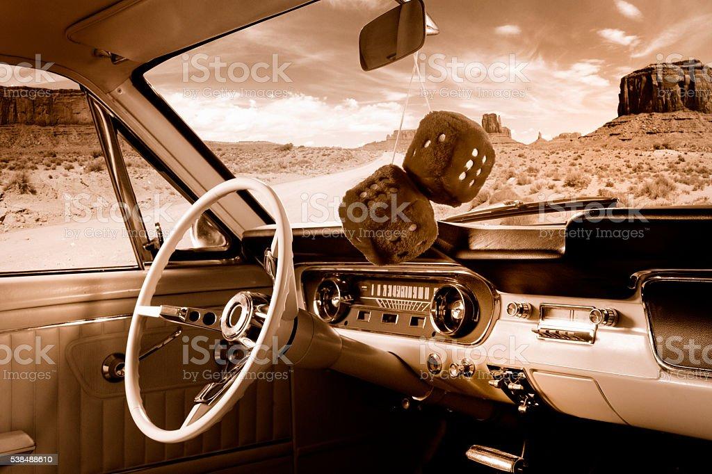 Fuzzy Mirror Dice In Classic Car Interior In Sepia Stock Photo