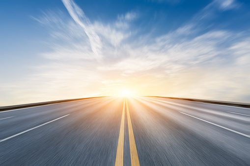 Fuzzy motion asphalt highway Beautiful scenery at sunset