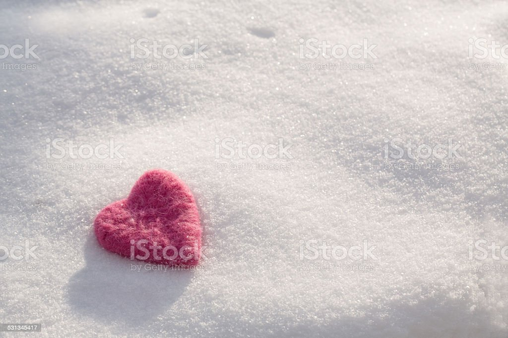 Fuzzy Pink Valentines Day Heart In Snow stock photo