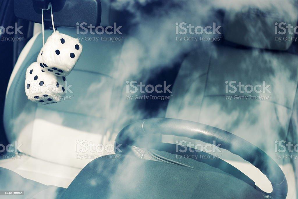 Fuzzy white dice stock photo
