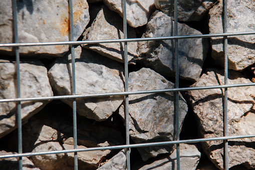 Gabion, metal basket filled with thick stones