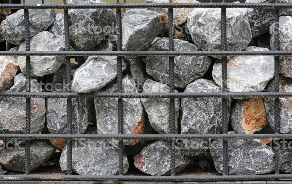 Gabion wall, Stone with steel bar. stock photo