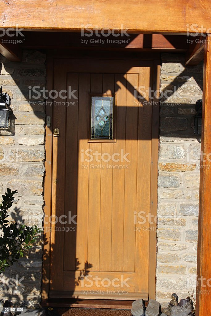 Gable design wooden open porch and front door / doorstep, cobblestone-bricks stock photo