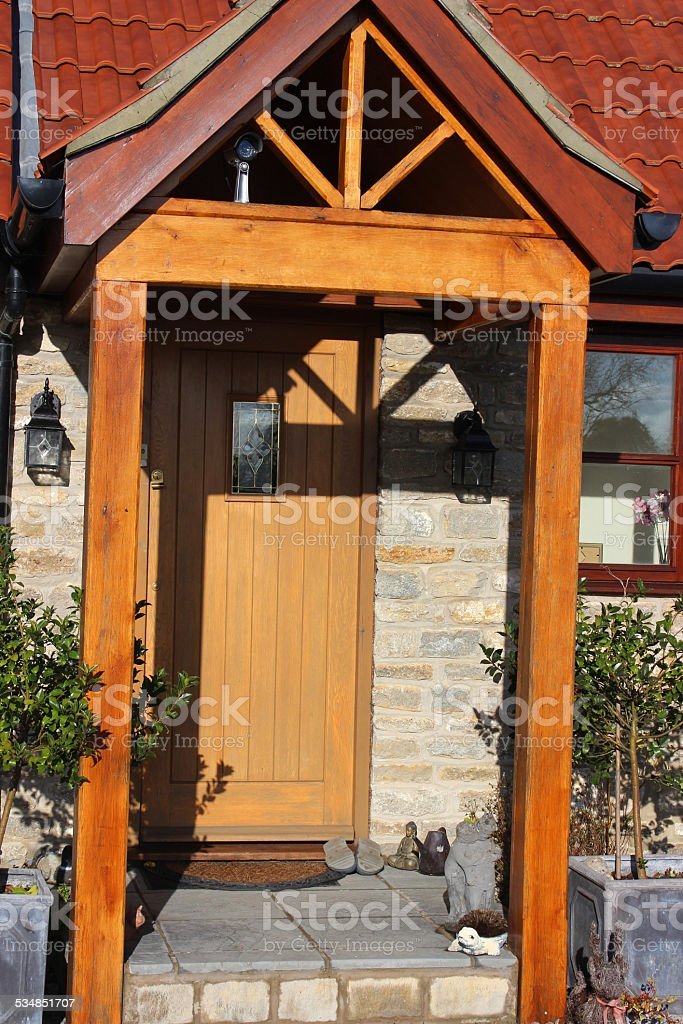 Gable design wooden open porch and front door / doorstep, security-camera stock photo