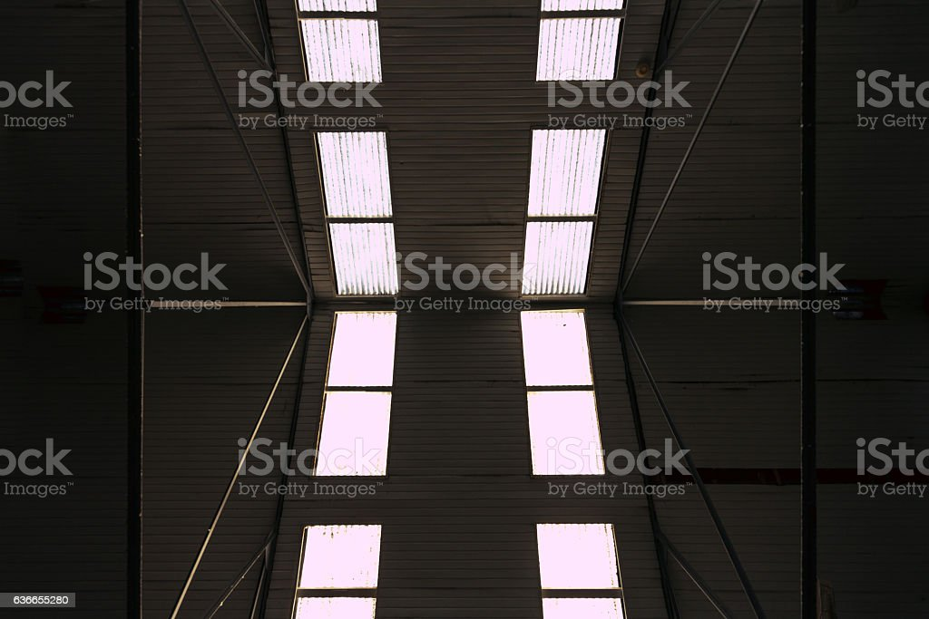 Gable roof of an old barn with skylights stock photo