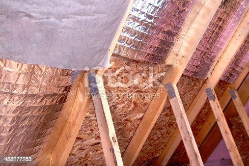 istock Gable View of Ongoing House Attic insulation Project 488277253