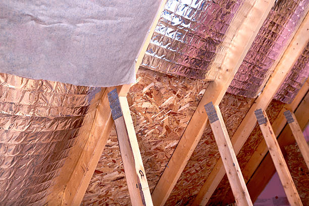 Gable View of Ongoing House Attic insulation Project stock photo