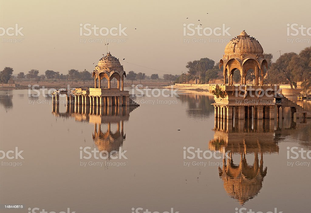Gadi Sagar lake at jaisalmer, Rajasthan in India at sunrise stock photo