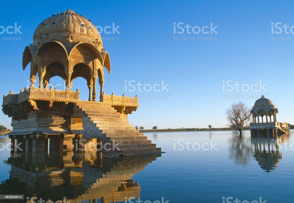 "Gadi Sagar lake in Jaisalmer, Rajasthan, India ""Artistically carved Chattris, Temples, Shrines and Ghats surround the banks of Gadi Sagar lake. Gadi Sagar lake is one of the most important tourist attractions in Jaisalmer.Jaisalmer, Rajasthan, India."" Ancient Stock Photo"