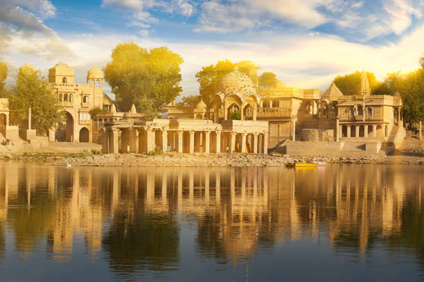 Cтоковое фото Gadi Sagar temple on Gadisar lake Jaisalmer, India.