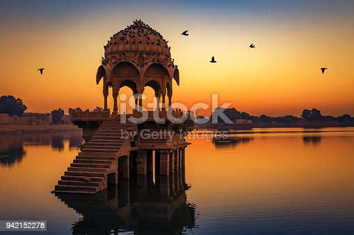 istock Gadisar lake at Jaisalmer Rajasthan at sunrise with ancient temples and archaeological ruins. 942152278