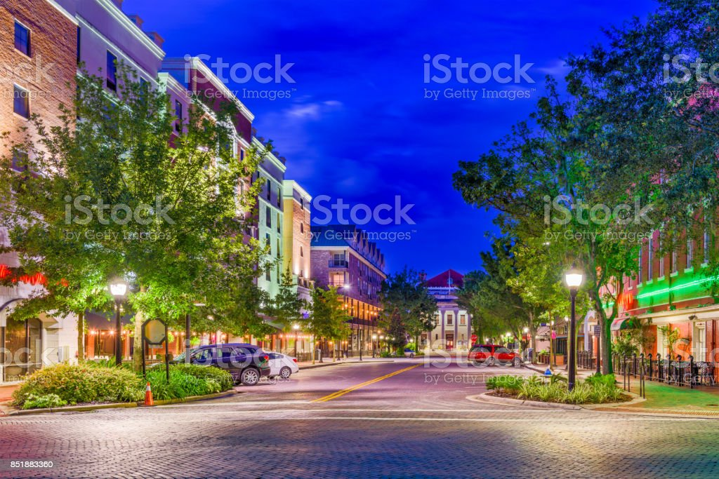Gainesville, Florida, USA Gainesville, Florida, USA downtown at twilight. Alley Stock Photo