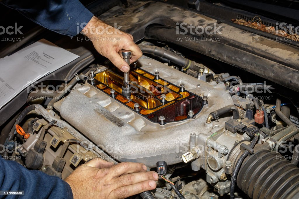 Gaining access to the engine stock photo