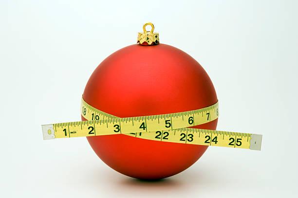 gaining weight at christmas - lichaamsbewustzijn stockfoto's en -beelden