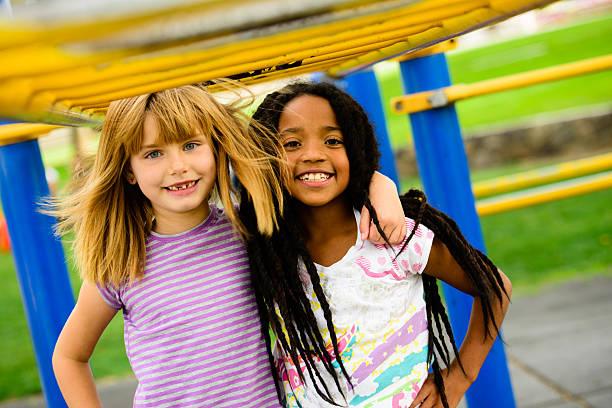 gal pals on the playground - 6 7 jaar stockfoto's en -beelden