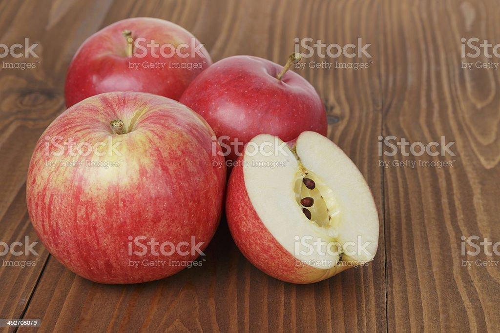 gala apples on wood table stock photo