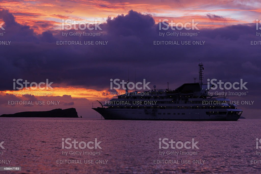 Galapagos Explorer II Cruise Ship at Sunset stock photo