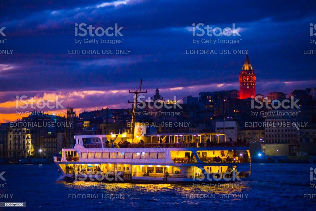 Galata tower and city lines ferry after sunset/Istanbul,Turkey - Zbiór zdjęć royalty-free (Architektura)
