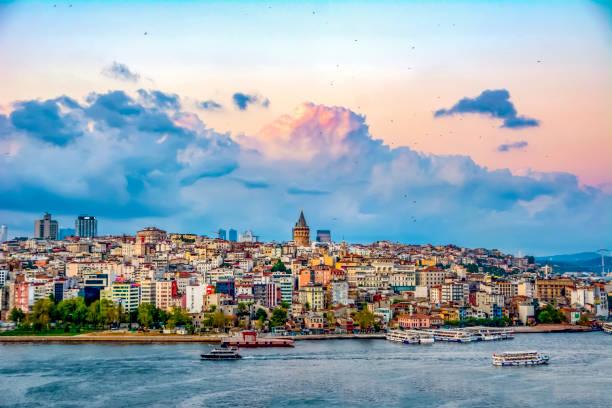 galata tower, galata bridge, karakoy district and golden horn, istanbul – turkey - стамбул стоковые фото и изображения