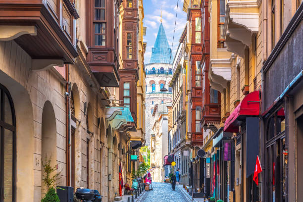 galata tower in istanbul, view from the narrow street - каракёй стамбул стоковые фото и изображения