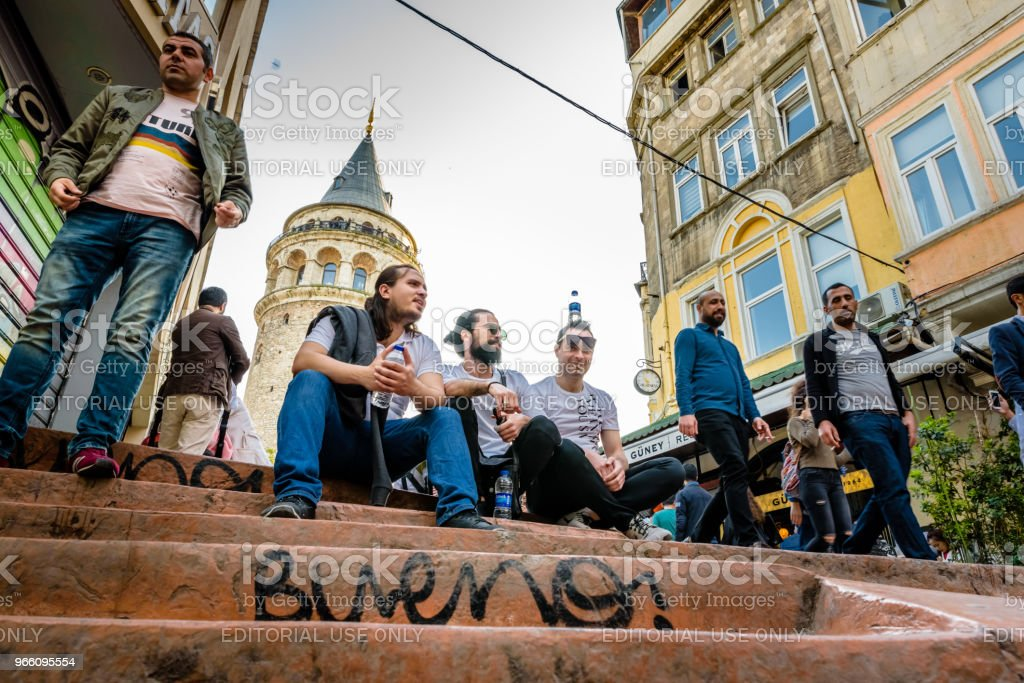 Galata Tower,a medieval stone tower in Istanbul,Turkey - Royalty-free Adult Stock Photo