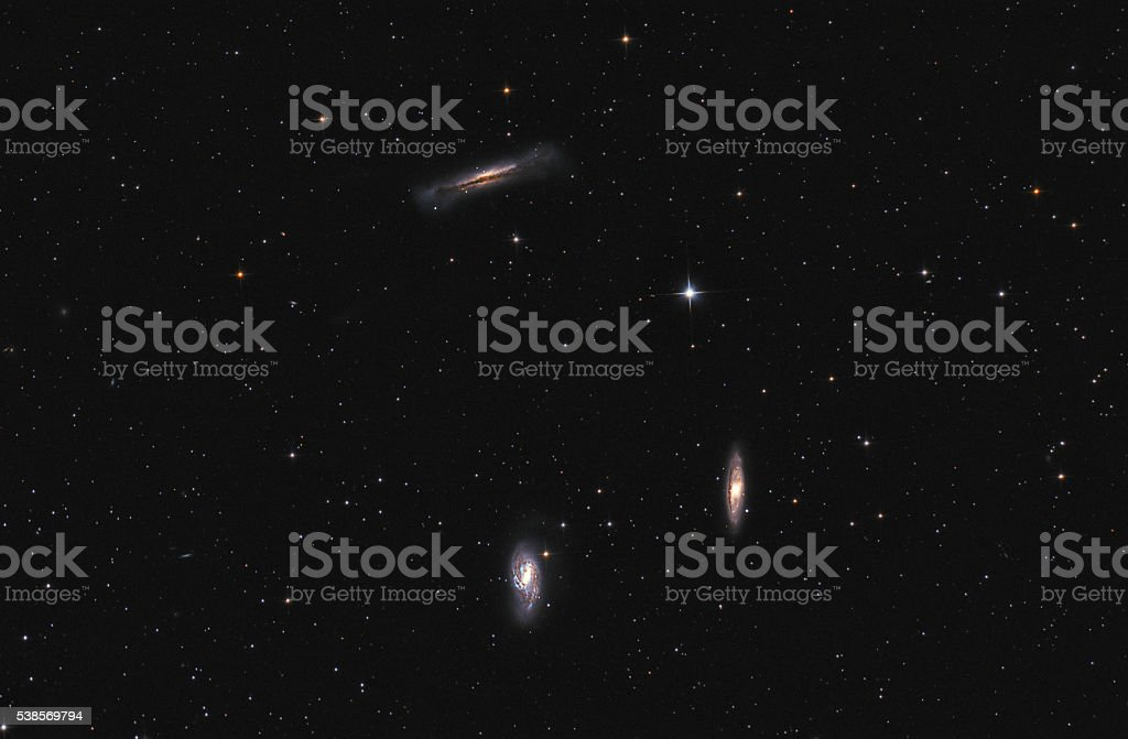 Galaxies in space - Leo Triplet stock photo