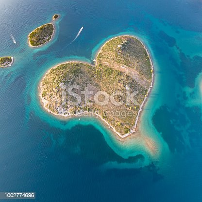 Aerial of the heart shaped Island Galešnjak. Located in the Pašman Canal of the Adriatic, between the islands of Pašman and the town of Turanj on mainland Croatia. Converted from RAW.