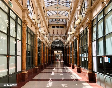 Galerie Colbert entrance corridor is one of the most beautiful covered passage in Paris, near National Institut of Art History, Galerie Vivienne and Palais Royal, Comédie Française. Paris in deuxième arrondissement (2nd district). The gallery is empty during epidemic Covid 19 virus in France .