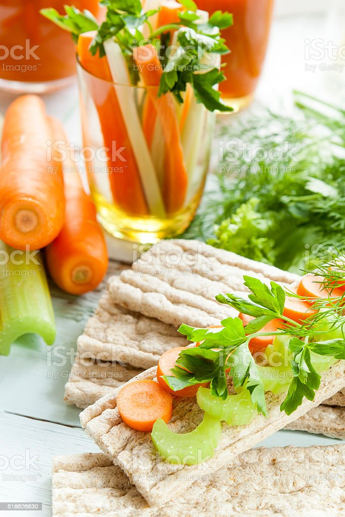 Galette rye with fresh carrots, celery and parsley royalty-free stock photo