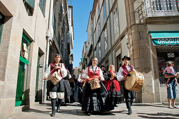 Galician musicians  march to traditional music on Santiago's street. stock photo