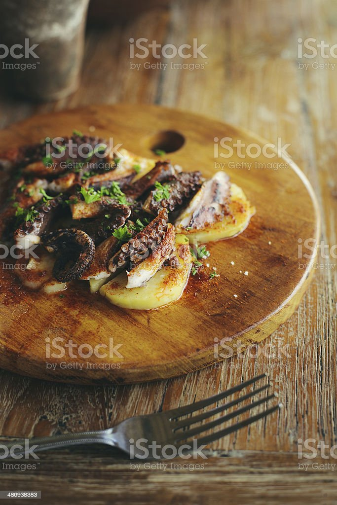 Galician style octopus with boiled potatoes royalty-free stock photo