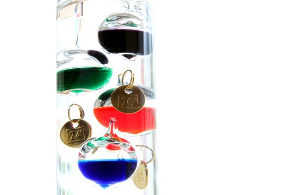 Galileo thermometer with glass balls isolated on white showing temperature Galileo thermometer with glass balls isolated on white showing temperature galileo galilei stock pictures, royalty-free photos & images