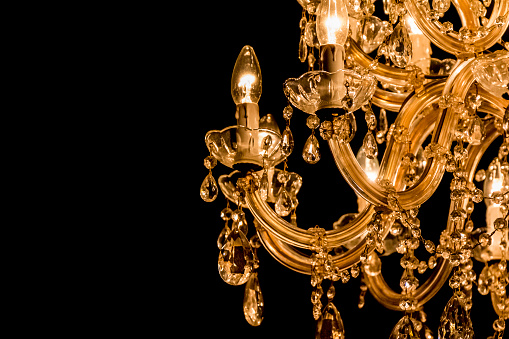 Gallant chandelier with light candles and dark side background