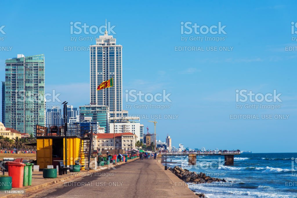 Galle Face Green beach and waterfront park in Colombo, Sri Lanka Colombo, Sri Lanka - April 5, 2019: Galle Face Green beach and waterfront park and residential area in Colombo, Sri Lanka Beach Stock Photo