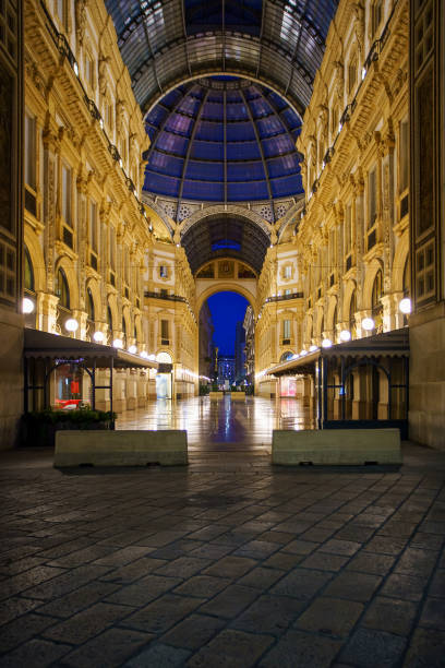 Galleria Vittorio Emanuele II interior at night in Milan city, Italy stock photo