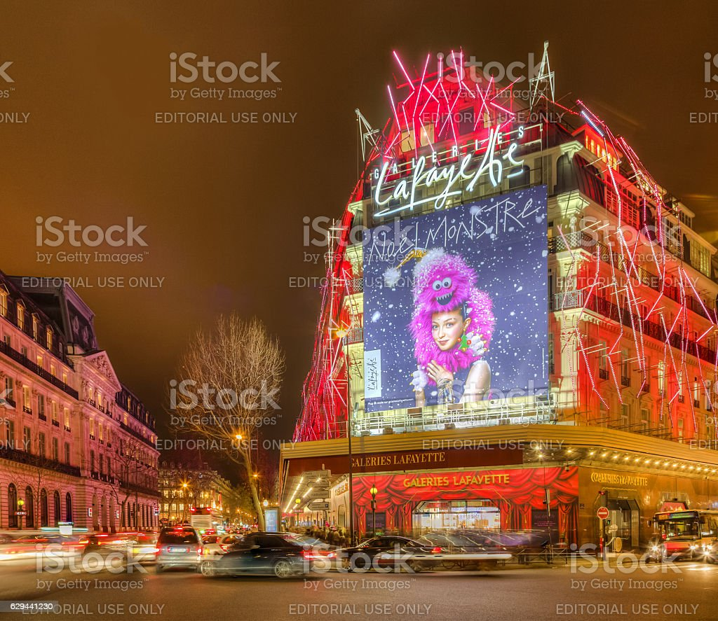 Galleries Lafayette in a Winter Night in Paris Paris, France - December 21, 2014: Night aspect of Galleries Lafayette and The Haussmann Boulevard decorated for winter holidays in Paris on December 21, 2015. Architecture Stock Photo