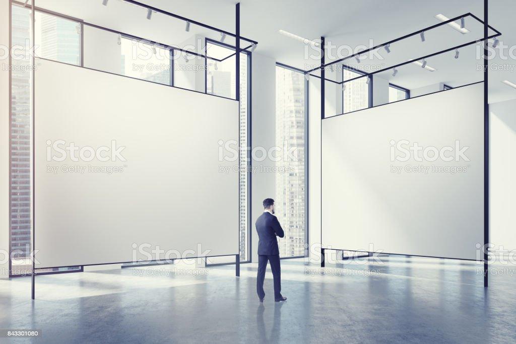 Gallery in a loft, man stock photo