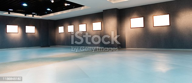 508897972 istock photo Gallery interior with group of empty frame on wall 1156845182