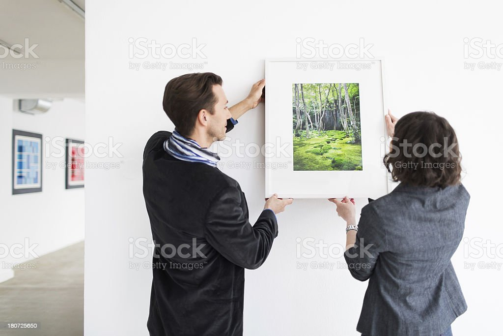 Gallery Owner Hanging Picture stock photo