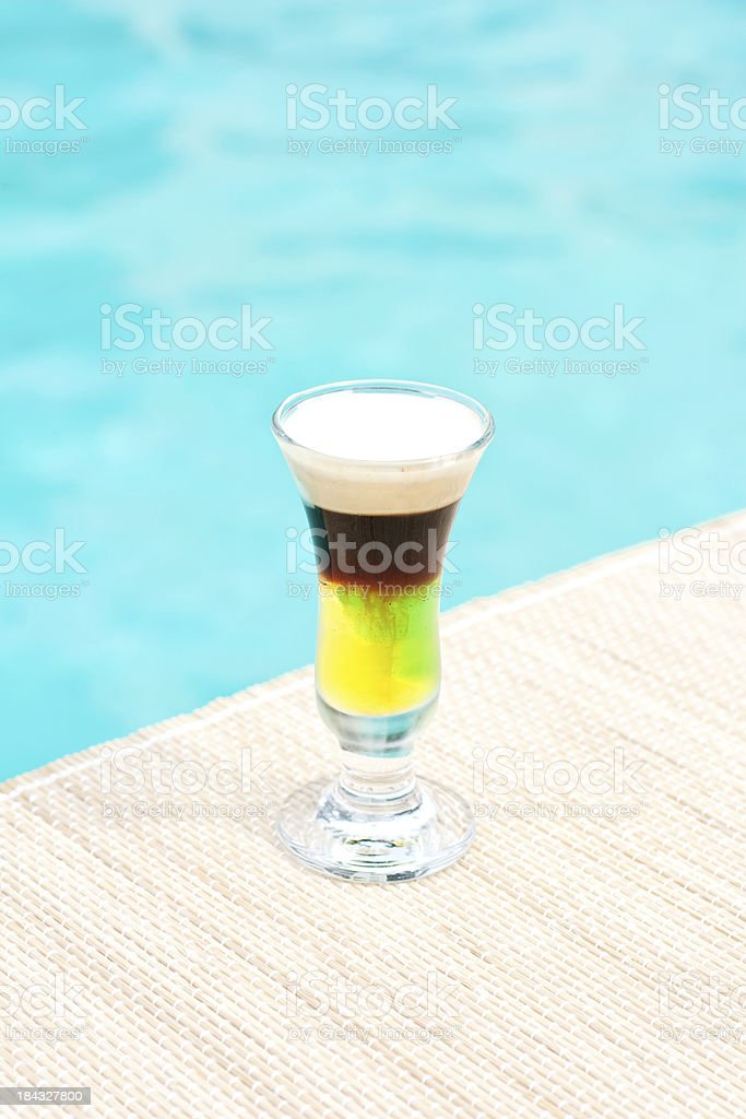 Galliano Hot Shot classic  cocktail near waterpool on  mat stock photo