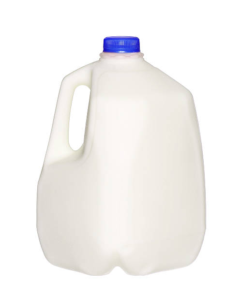 gallon Milk Bottle with blue Cap Isolated on White gallon Milk Bottle with blue Cap Isolated on White Background. gallon stock pictures, royalty-free photos & images