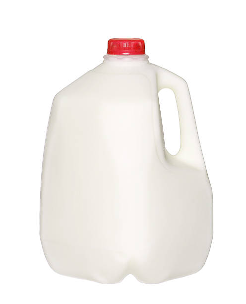 gallon Milk Bottle with Red Cap Isolated on White gallon Milk Bottle with Red Cap Isolated on White Background. gallon stock pictures, royalty-free photos & images
