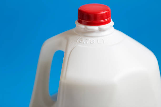 Gallon Milk Jug - 3.78 L Close-up of part of a gallon or 3.78 L whole milk jug. gallon stock pictures, royalty-free photos & images