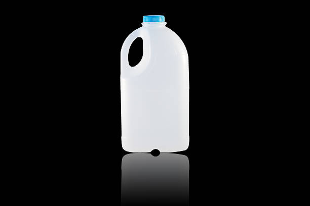 Gallon Milk A Gallon Milk isolate on the black background gallon stock pictures, royalty-free photos & images