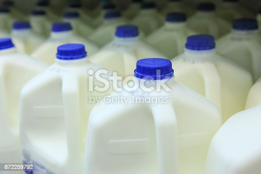Gallons of fresh milk in freezer.