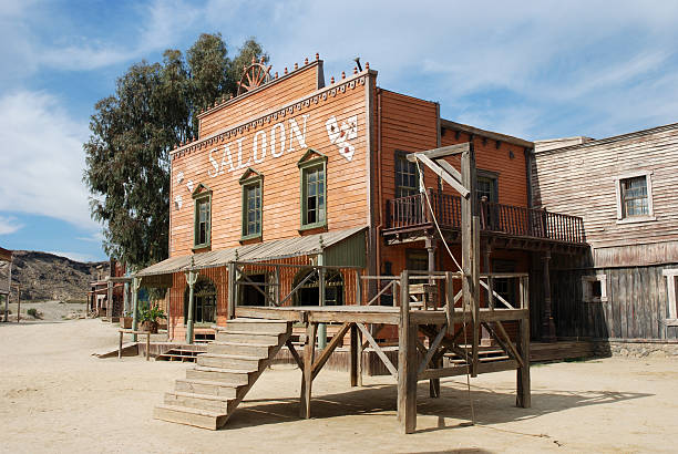gallow and saloon - western town stock photos and pictures